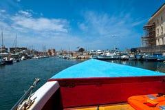Boat at Syracuse harbor near Ortigia bridge, Sicily Stock Photo