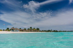 The boat in t the Caribbean Sea and the view of the beach of Cayo Largo, Cuba out of the water Stock Images
