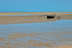 Boat on tabeach. Boat on a beach at low tide in Tanzania Stock Photography
