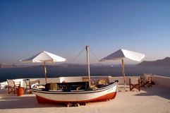 Boat and tables. On a top terrace by the sea stock photo