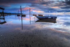 Boat at Tanjung aru beach, Labuan. Malaysia 12. Boat at Tanjung Aru beach Labuan Malaysia. with beautiful sunrise Royalty Free Stock Photography