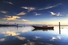 Boat at Tanjung aru beach, Labuan. Malaysia 01. Wrick at Tanjung Aru beach Labuan Malaysia. with beautiful sunrise Royalty Free Stock Image