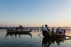 Boat in Taungthaman  lake is watching Sunset at U Bein Bridge, A Royalty Free Stock Photo