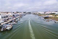 Boat on Tavira sea channel Stock Image