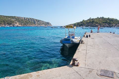 Boat taxi Sant Elm Mallorca. SANT ELM, MALLORCA, SPAIN - AUGUST 5, 2016: RIB boat taxi to Port d'Andratx moored on the quay on a sunny summer day in August 5 in Royalty Free Stock Photos
