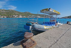 Boat taxi Sant Elm Mallorca. SANT ELM, MALLORCA, SPAIN - AUGUST 5, 2016: Boat taxi to Port d'Andratx moored on the quay on a sunny summer day in August 5 in Sant Royalty Free Stock Image