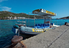 Boat taxi Sant Elm Mallorca. SANT ELM, MALLORCA, SPAIN - AUGUST 5, 2016: Boat taxi to Port d'Andratx moored on the quay on a sunny summer day in August 5 in Sant Royalty Free Stock Photos