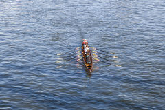 Boat team trains at river main Stock Photos