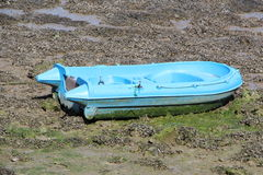Boat tender on silt. At low tide Royalty Free Stock Images