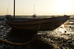 Boat Tethered When Tide is Out  Stock Images
