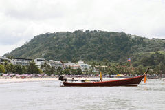 Boat on Thai beach Stock Photo