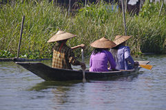 Boat with three peoples on Inle Lake. Stock Photos