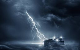 Boat in the thunderstorm stock photography