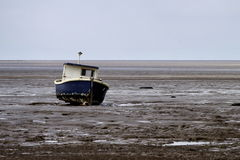 Boat in tide out. Boat in the Mud. During tide out Royalty Free Stock Photos