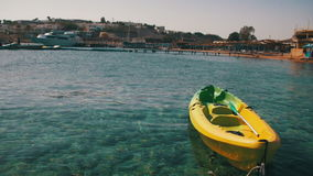 Boat Tied to a Pier in the Red Sea on the Beach Background stock video footage