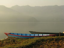 Boat tied to the shore of Fewa Lake stock images