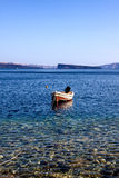 A boat tied up in the clear waters of Primosten Royalty Free Stock Photos