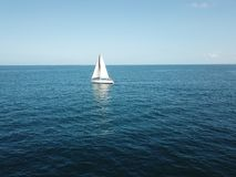 Boat in to the blue ocean stock photography