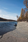 The boat to the shore of the Siberian taiga river Stock Photo
