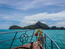 Boat to tropical islands stock photos