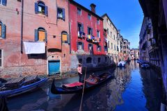 A boat to venice in italy in the canals in town with a gondolier royalty free stock photo
