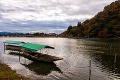 Boat and Togetsukyo bridge, Arashiyama Royalty Free Stock Image