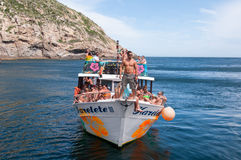Boat Tour Around Rocky Coast Royalty Free Stock Photo