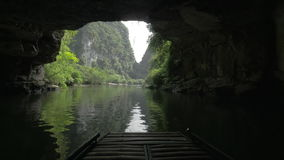Boat tour with cave visiting in Trang An, Vietnam stock video footage