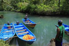 Boat Tour in Cokel River Pacitan. 22/03/2017, Pacitan, East Java, Indonesia: Boat for special interest tourism rushing the river pulled over the river Cokel Stock Image