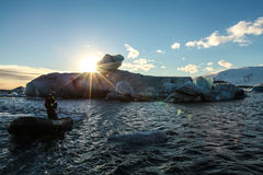 Boat tour in Jokulsarlon lagoon, Iceland. At sunny day Royalty Free Stock Image