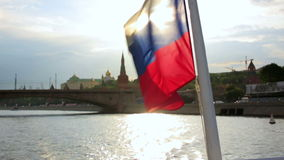 Boat Tour at Kremlin, Moscow. Boat Tour with russian flag at Kremlin, Moscow, from Moskva River stock video footage