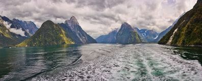 Boat tour on Milford Sound fjord in New Zealand. Touristic places in New Zealand, New Zealands tourism, panoramatic view of Milford sound, on the water stock image