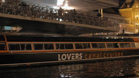 Boat tour in night Amsterdam stock video footage