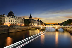 Boat tour on Seine river in Paris with sunset. Paris, France Stock Photos
