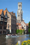 The boat with tourists on channel in Bruges Stock Photography