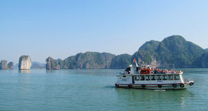 Boat with tourists in Ha Long Bay, near the island of Cat Ba, Vietnam Stock Images