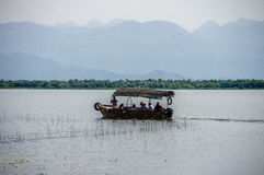 Boat with tourists on Lake. Skadar Royalty Free Stock Photography
