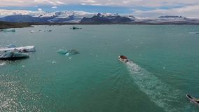 The boat with tourists is moving to the coast of Iceland. Andreev. stock video footage