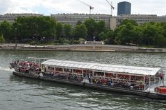 PARIS, FRANCE - MARCH 29, 2014: Boat with tourists on the river sena Paris royalty free stock images