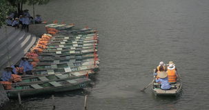 Boat with tourists sailing from mooring, Vietnam stock video
