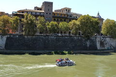 Boat with tourists sailing on the river Tiber Royalty Free Stock Images