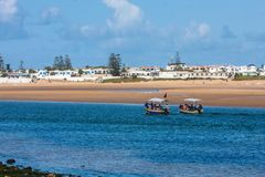 Boat with tourists in a small bay atlantic ocean, Morocco Royalty Free Stock Photos