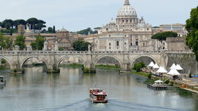 Boat with tourists on the Tiber River. ROME, ITALY - JUNE 1, 2017: Video 4K with Vatican Basilica, Sant Angelo Bridge and boat with tourists on the Tiber River stock footage