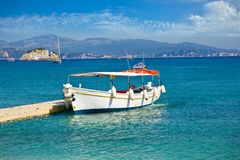 Boat for tourists on Valtos beach near Parga, Greece. royalty free stock images