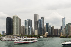 Boat tours in Chicago. Commercial tour boats take passengers on an Architectural tour of the cities buildings in Chicago Stock Photos