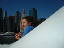 Boat tours in New York City. Girl enjoying an excursion boat on the Hudson River in New York City royalty free stock photo