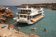 Boat tours in Platges de Comte. Platges de Comte, Ibiza, Balearic islands - August 29, 2014 : Boat tours stop in Platges de Comte Royalty Free Stock Image