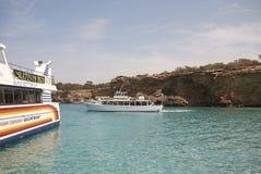 Boat tours in Platges de Comte. Platges de Comte, Ibiza, Balearic islands - August 29, 2014 : Boat tours stop in Platges de Comte Stock Photos