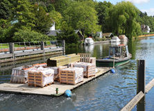 Boat towing supplies along a River Stock Images