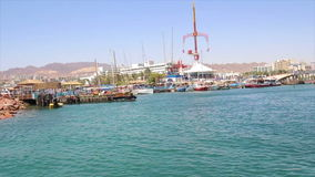 Boat tracking shot of the entrance to the marina of Eilat. stock video footage